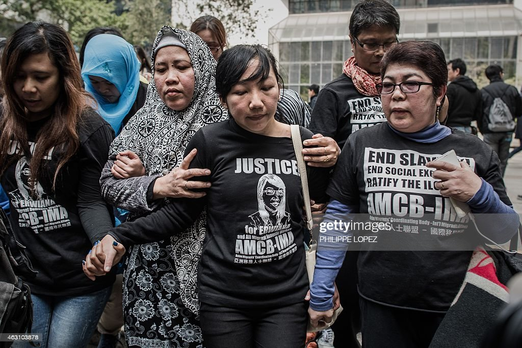 Indonesian former maid <a gi-track='captionPersonalityLinkClicked' href=/galleries/search?phrase=Erwiana+Sulistyaningsih&family=editorial&specificpeople=12341887 ng-click='$event.stopPropagation()'>Erwiana Sulistyaningsih</a> (C) leaves the court of justice in Hong Kong on February 10, 2015 after her employer was convicted of beating and starving the Indonesian maid in a 'torture' case that sparked international outrage and spotlighted the plight of migrant domestic workers in the Middle East and Asia. The verdict, read out to a packed courtroom, was met with cheers by activists and supporters of Sulistyaningsih, a former domestic helper who has become the face of a campaign for improved workers' rights in the financial hub. AFP PHOTO / Philippe Lopez