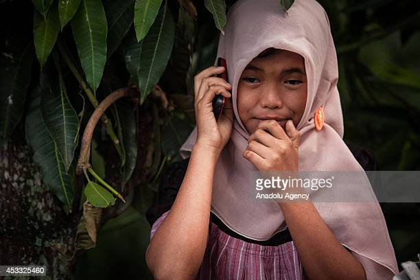 Indonesian girl Raudhatul Jannah is seen after being reunited with her family in Meulaboh Aceh Indonesia on August 7 2014 Raudhatul Jannah went...