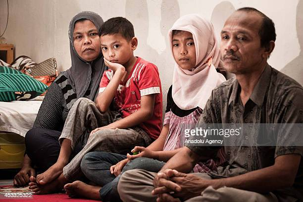 Indonesian girl Raudhatul Jannah sits with her family after being reunited in Meulaboh Aceh Indonesia on August 7 2014 Raudhatul Jannah went missing...