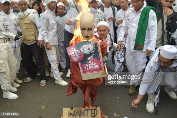 Indonesian hardline Muslim group Front Pembela Islam or the Islamic Defender Front together with Forum Umat Islam activists burn an effigy of a...