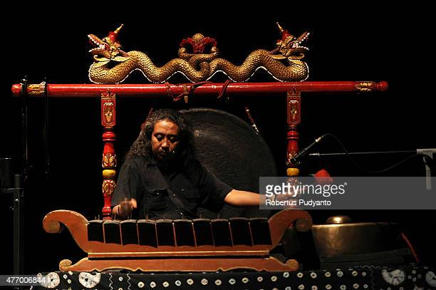 Indonesian Jijit Azied Dewa plays gamelan during Indonesia and France puppet show collaboration titled 'Guignol Meets Punakawan' at Cak Durasim Hall...