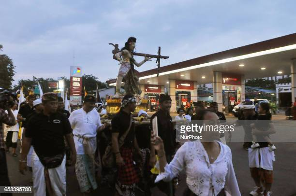 Indonesian Kids carry giant effigies in the form of the devil whose local name is 'Ogohogoh during a parade on the evening of the Day of Silence...