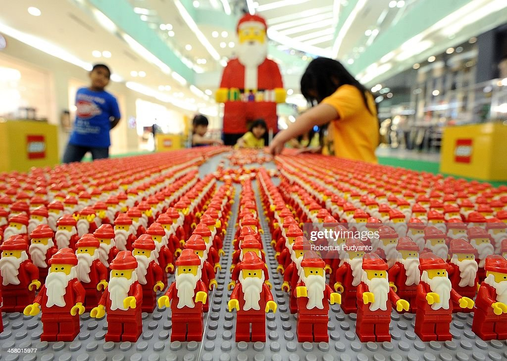 Indonesian kids make up 10,000 LEGOs of mini Santa Claus figure display for charity on December 19, 2013 in Surabaya, Indonesia. Indonesian Christians celebrate holiday season while on December 12, Indonesian police warned that Islamic extremists may be planning to target worshipers at Christmas and New Years celebrations in the capital Jakarta and other parts of the country.