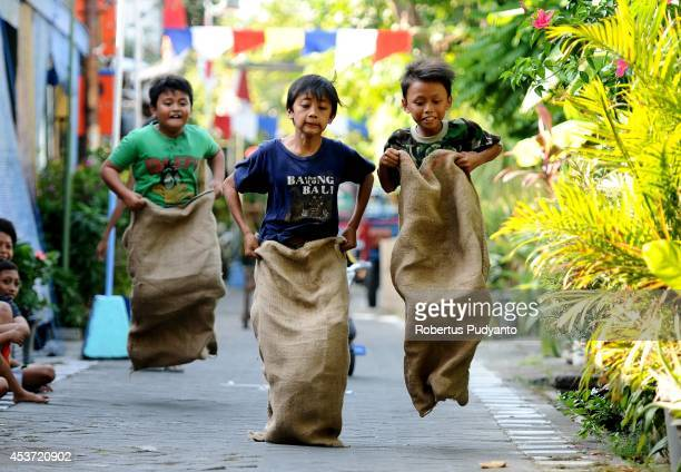 Indonesian kids take part in the sack race competition during the Indonesian 69th Independence Day Anniversary celebration on August 17 2014 in...