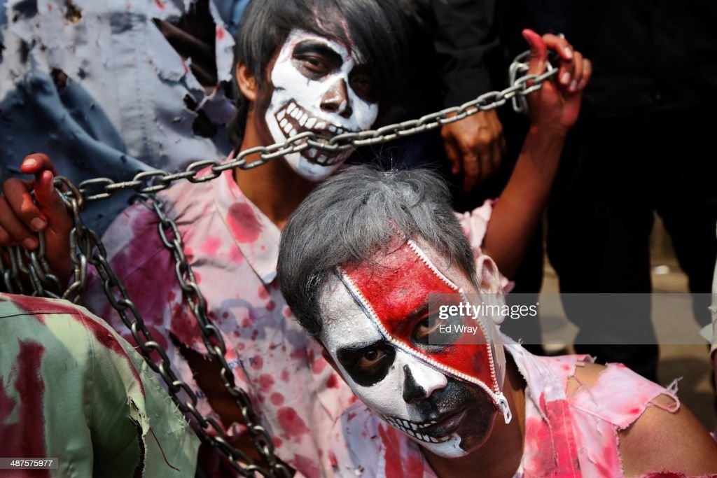 Indonesian labour activists representing underpaid and downtrodden workers perform during a Labour Day protest on May 1, 2014 in Jakarta, Indonesia. Protesters across Indonesia have organised rallies to demand higher wages, as Indonesia recognises its first national labour day holiday.