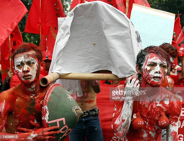 Indonesian labourers carry a coffin symbolizing 'suffering workers' as they stage a rally to mark May Day in Jakarta 01 May 2007 Tens of thousands of...