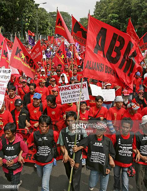 Indonesian labourers march during a rally to mark May Day in Jakarta 01 May 2007 Tens of thousands of workers were assembling across Indonesia to...