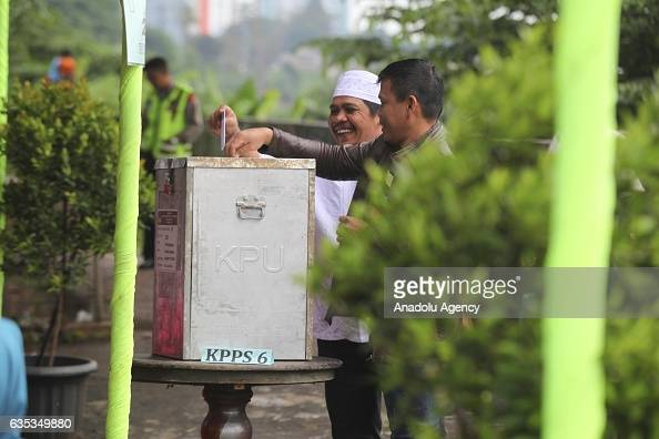 Indonesian man casts his ballot during election day to elect Jakarta Governor to a fiveyear term in Jakarta Indonesia on February 15 2017 Incumbent...