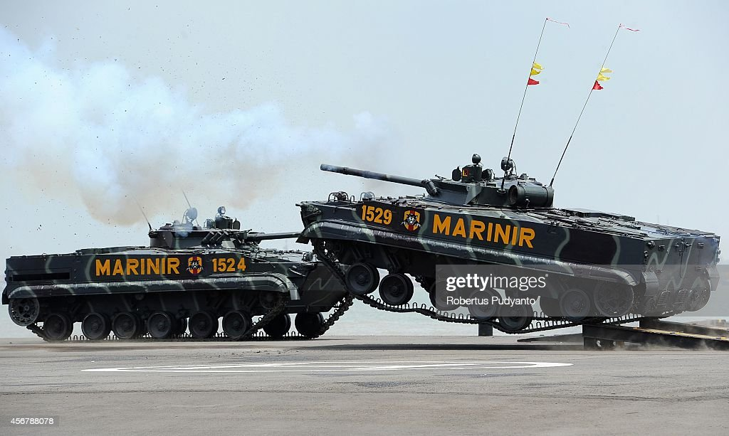 Indonesian Marine tanks jump and launch missiles during The 69th Republic of Indonesian Military Anniversary on October 7 2014 in Surabaya Indonesia...