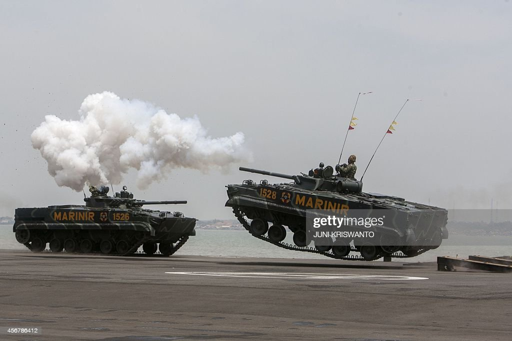 Indonesian marine tanks jump from a track during the celebration of the 69th anniversary of the Indonesian armed forces led by outgoing President...