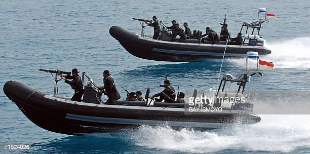 Indonesian marines antiterror troops sail speed boats during the simulation of the interception of a pirate ship as part of joint exercises with the...