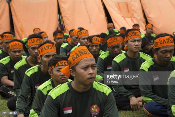 Indonesian men listen to an instructor during a three day induction course on July 22 2017 in Kebumen Indonesia Banser the security unit of...