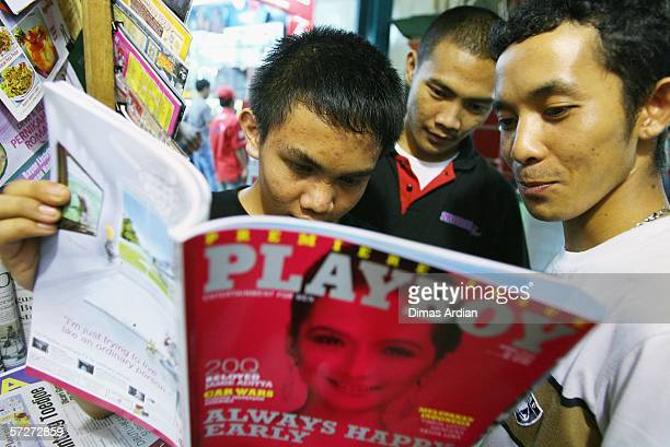 Indonesian men take a look at the premiere issue of Playboy magazine at a newsstand April 7 2006 in Jakarta Indonesia The magazine has gone on sale...