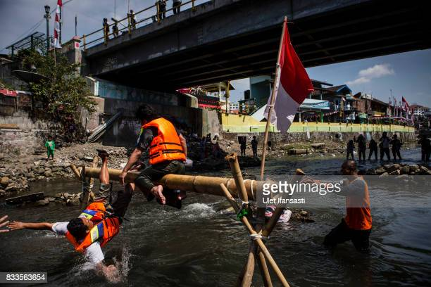 Indonesian men take part in pillow fighting competition during celebrations for the 72nd Indonesia National Independence day at Code river on August...