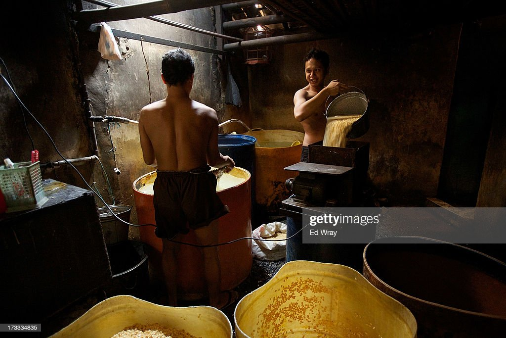 Indonesian men work at a small tempeh factory on July 12, 2013 in Jakarta, Indonesia. Tempeh is an Indonesian staple made from fermented soy beans. The Indonesian government has said that it will increase food imports during the Ramadan fasting month to reduce inflation caused by increased food consumption during the month leading up to and during the Eid Al Fitr holiday marking the end of the fasting month.