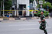 Indonesian military guard the blast site after a series of explosions hit the Indonesia capital on January 14 2016 in Jakarta Indonesia Reports of...