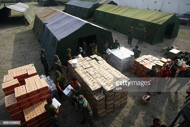 Indonesian military soldiers prepare food supplies and shelters in Kediri East Java on February 15 2014 following the volcanic eruption of Mouth...