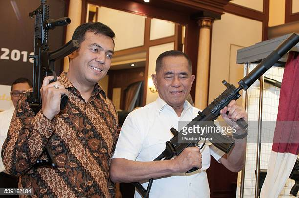 Indonesian Minister of Defense Ryamizard Ryacudu hold SS2 rifle and PT Pindad Director Silmy Karim with SS3 as the new rifle launching Pindad as...