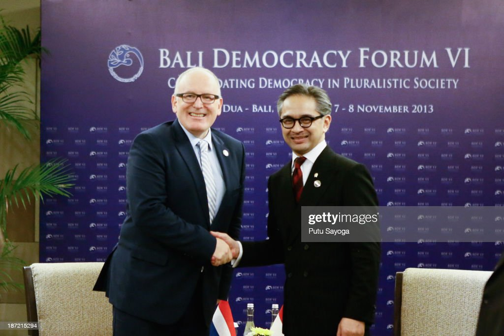 Indonesian Minister of Foreign Affairs <a gi-track='captionPersonalityLinkClicked' href=/galleries/search?phrase=Marty+Natalegawa&family=editorial&specificpeople=2862416 ng-click='$event.stopPropagation()'>Marty Natalegawa</a> (R) shakes hands with Netherlands Minister of Foreign Affairs <a gi-track='captionPersonalityLinkClicked' href=/galleries/search?phrase=Frans+Timmermans&family=editorial&specificpeople=4666763 ng-click='$event.stopPropagation()'>Frans Timmermans</a> (L) at a bilateral meeting during the Bali Democracy Forum on November 7, 2013 in Denpasar, Bali, Indonesia. This year's Bali Democracy Forum has attracted increased attention as Australia's Foreign Minister Julie Bishop returns to Indonesia amid controversy surrounding Australia's involvement in 'intelligence-gathering' activities. The forum is held every year and aims to 'enhance democratic participation in a changing world'.