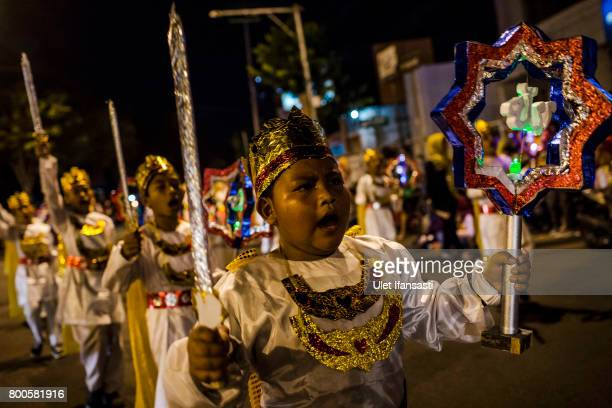 Indonesian Muslim children parade on the streets as Muslims celebrate Eid AlFitr on June 24 2017 in Yogyakarta Indonesia Eid AlFitr marks the end of...