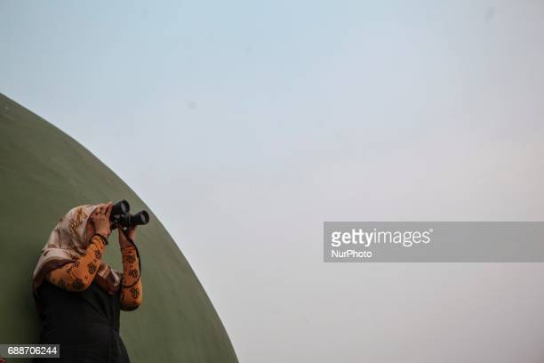 Indonesian muslim hold a Rukyatul Hilal to see the new crescent moon that determines the start of Ramadan in Jami Musyari'in Mosque Jakarta Indonesia...