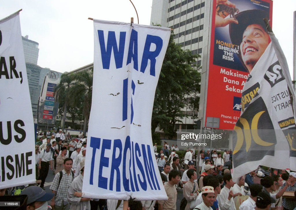 Indonesian muslim protesters march during a demonstration October 19 2001 on the main street in Jakarta Indonesia More than 8000 Indonesian muslim...