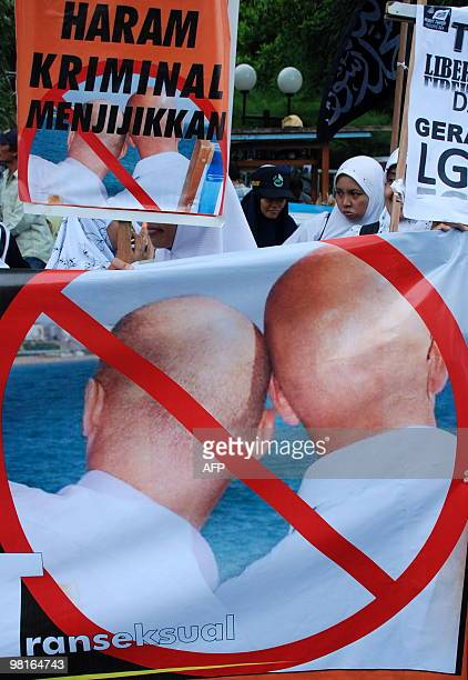 Indonesian Muslim protestors of Muslim organization 'Hizbuth Tahrir' hold a banner reading 'Forbidden Crime and Disgusting' refering to Lesbian Gay...