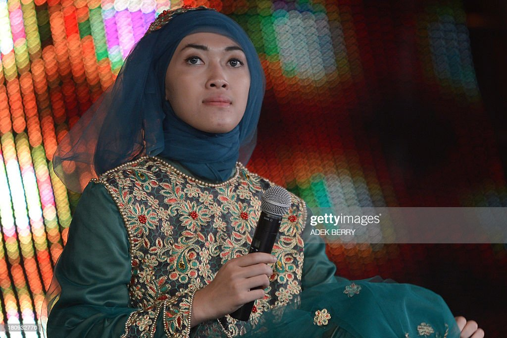 Indonesian Muslimah World pageant contestant Putri Puspita Wardani takes part in a rehearsal for the grand final of the contestin Jakarta on September 18, 2013. The finale of a beauty pageant exclusively for Muslim women will take place in the Indonesian capital on September 18, in a riposte to the Miss World contest in Bali that has drawn fierce opposition from Islamic radicals.