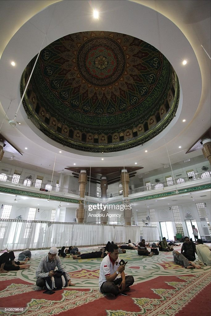 Indonesian Muslims are seen at the Istiqlal Mosque for Itikaf, a spiritual practice held during the last ten days of Islamic fasting month of Ramadan, in Aceh, Indonesia on June 29, 2016. Itikaf devotees spend ten days and nights to worship in the mosque until the end of Ramadan, devoting their time to read the holy Quran and pray to mark Shab-e-Qadr.