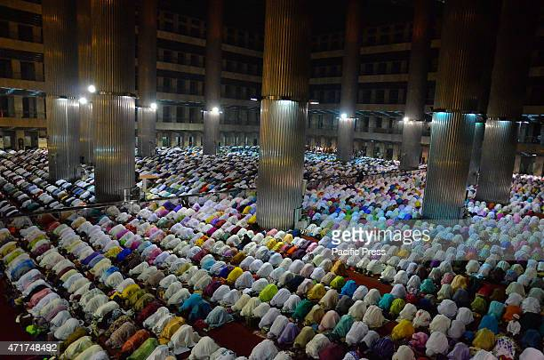 Indonesian Muslims at Istiqlal mosque in Jakarta perform the 'tarawih' prayer which marks the first eve of Islam's holy month Ramadan as the world's...