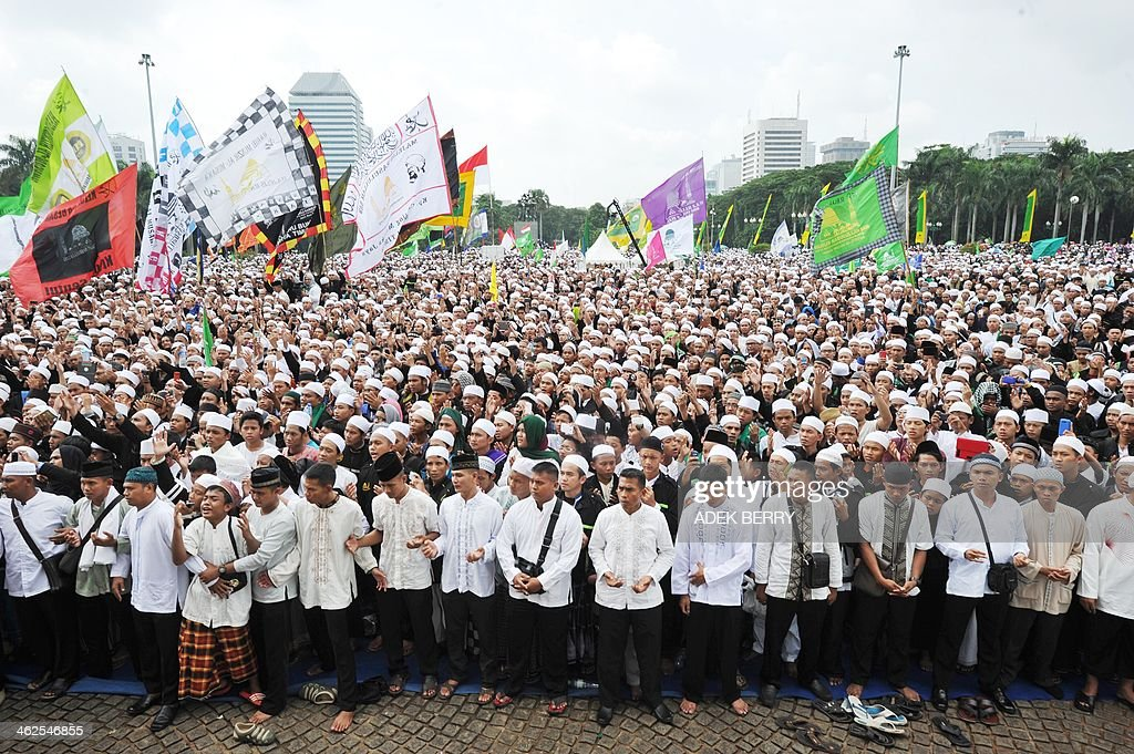 Indonesian Muslims attend a mass prayer to celebrate Muhammad's birthday in Jakarta on January 14, 2014. Thousands of Muslims in Indonesia celebrated the birthday of prophet Muhammad called Mawlid or locally maulud, which occurs in the third month in the Islamic calendar. AFP PHOTO / ADEK BERRY