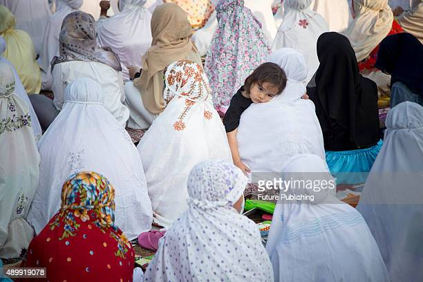 Indonesian Muslims attend Eid AlAdha prayers at Football field Ciater Raya on September 24 2015 in Banten Indonesia Jefta Images / Barcroft Media UK...
