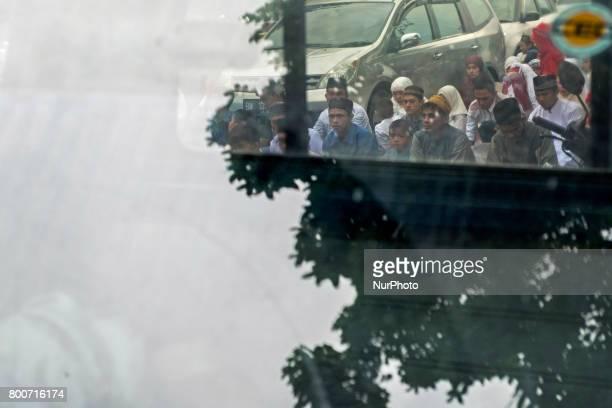 Indonesian Muslims attend Eid AlFitr prayer at AnNur Grand Mosque on June 25 2017 in Pekanbaru Indonesia Eid AlFitr marks the end of Ramadan during...
