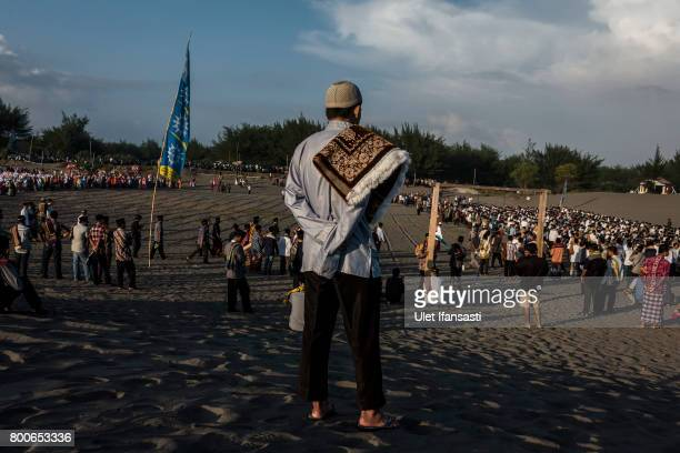 Indonesian Muslims attend Eid AlFitr prayer on 'sea of sands' at Parangkusumo beach on June 25 2017 in Yogyakarta Indonesia Eid AlFitr marks the end...