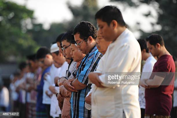 Indonesian Muslims attend to Eid AlAdha prayer on September 24 2015 in Surabaya Indonesia Muslims worldwide celebrate Eid AlAdha to commemorate the...
