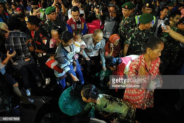 Indonesian Muslims devotees fight over for holy water during the 1437th AlHijra Islamic New Year eve celebration on first Muharram at Mangkunegaran...