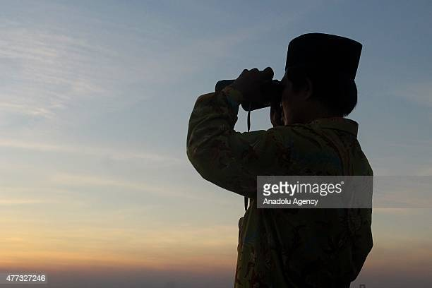 Indonesian Muslims hold a Rukyatul Hilal to see the new crescent moon that determines the start of Ramadan Holy Month on Tuesday June 16 in Surabaya...