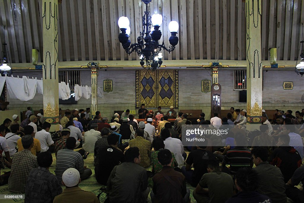 Indonesian muslims listen the preaching before break their fast at Kauman Great Mosque, Yogyakarta, Indonesia on June 30, 2016. The Islamic holy month of Ramadan is celebrated by Muslims around the world marked by fasting, abstaining from food, sex and smoking from dawn to dusk.