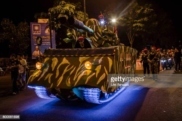 Indonesian muslims parade on the streets in military costume as Muslims celebrate Eid AlFitr on June 24 2017 in Yogyakarta Indonesia Eid AlFitr marks...