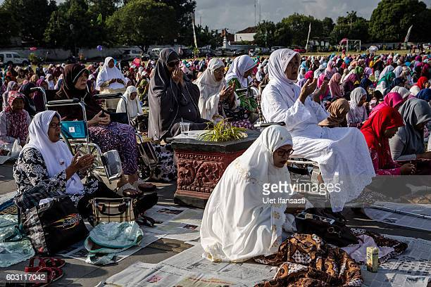 Indonesian Muslims perform Eid alAdha prayer at southern city square known as 'Alunalun kidul' on September 12 2016 in Yogyakarta Indonesia Muslims...