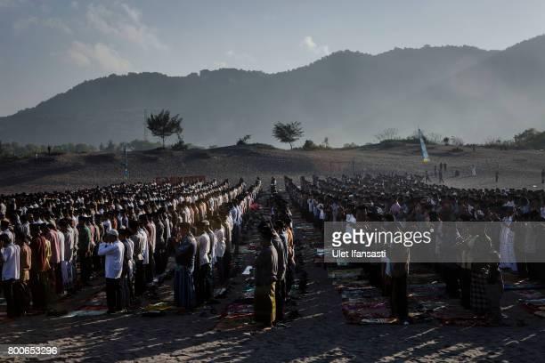 Indonesian Muslims perform Eid AlFitr prayer on 'sea of sands' at Parangkusumo beach on June 25 2017 in Yogyakarta Indonesia Eid AlFitr marks the end...