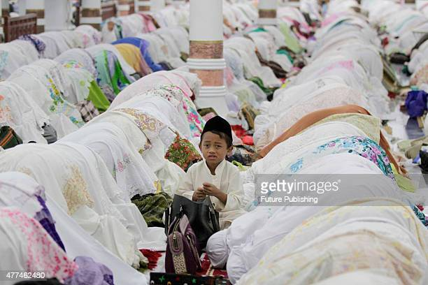 Indonesian Muslims perform the 'tarawih' prayer marking the first eve of Islam's holy month Ramadan at Raya Baiturrahman mosque on June 17 2015 in...