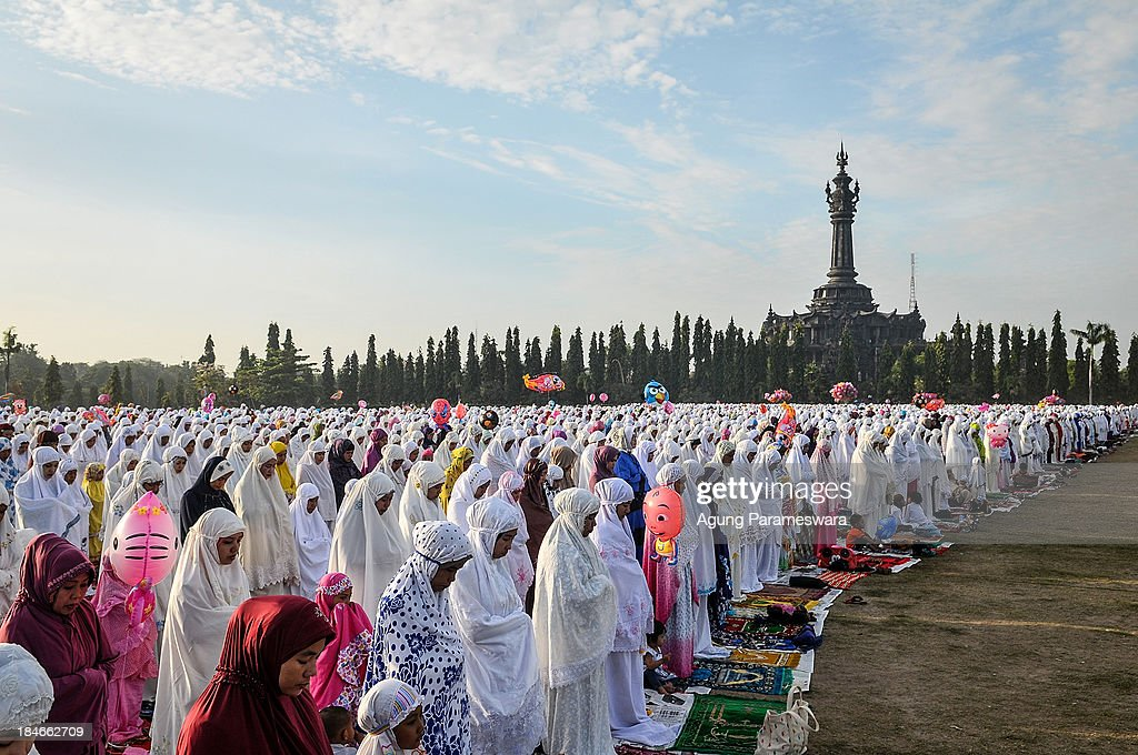 Indonesian Muslims pray during mass to celebrate Eid al-Adha at Bajra Sandhi monument on October 15, 2013 in Denpasar, Bali, Indonesia. Eid Al-Adha, known as the 'Feast of the Sacrifice', is one of the most significant festivals on the Muslim calendar. The holiday marks the end of the Haji Pilgrimage and serves as day to remember the Islamic profit Ibrahim, and his willingness to sacrifice his son to God. On this day, Muslims in countries around the world start the day with prayer and spend time with family, offer gifts and often give to charity. It is customary for Muslims family to honour Allah by sacrificing a sheep or goat and sharing the meat amongst family members.