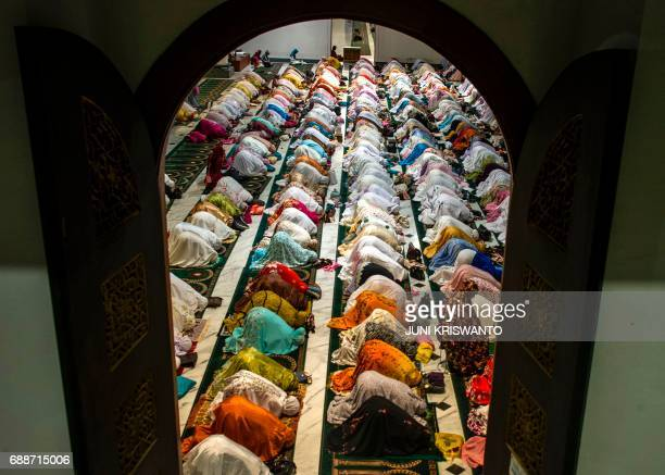 Indonesian Muslims pray during the start of the holy month of Ramadan on May 26 2017 at the Al Akbar mosque in Surabaya More than 15 billion Muslims...