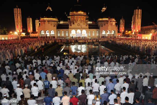 Indonesian Muslims pray during the start of the holy month of Ramadan on May 26 2017 at the Baiturrahman mosque in Banda Aceh Aceh province More than...