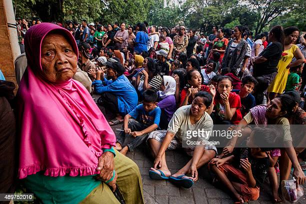 Indonesian Muslims queue to get a share of the sacrificial meat during celebrations of Eid alAdha at Sunda Kelapa Mosque on September 24 2015 in...