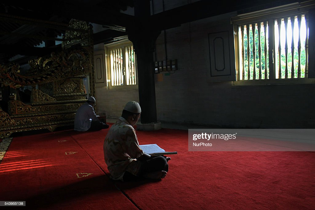 Indonesian Muslims read the Qur'an at Kauman Great Mosque, Yogyakarta, Indonesia on June 30, 2016. The Islamic holy month of Ramadan is celebrated by Muslims around the world marked by fasting, abstaining from food, sex and smoking from dawn to dusk.