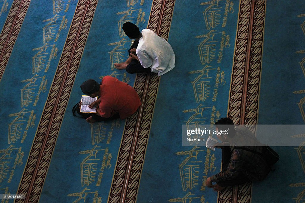 Indonesian Muslims read the Qur'an while waiting to break their fasting at Jogokariyan Mosque, Yogyakarta, Indonesia on June 25, 2016. The Islamic holy month of Ramadan is celebrated by Muslims around the world marked by fasting, abstaining from food, sex and smoking from dawn to dusk.