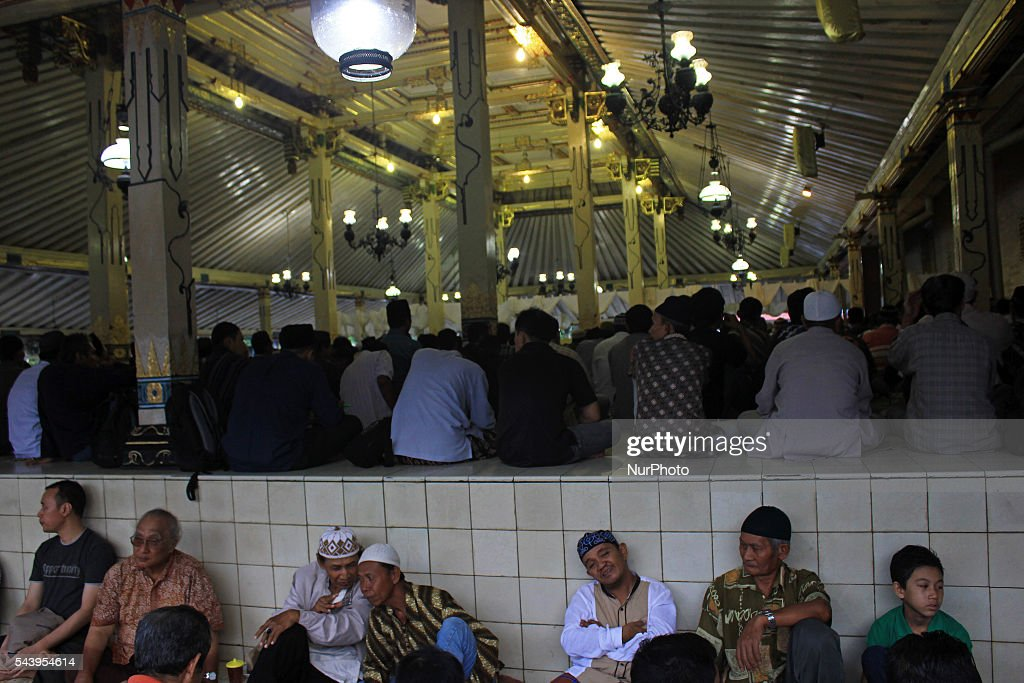 Indonesian Muslims sits as waiting to break fasting at Kauman Great Mosque, Yogyakarta, Indonesia on June 30, 2016. The Islamic holy month of Ramadan is celebrated by Muslims around the world marked by fasting, abstaining from food, sex and smoking from dawn to dusk.