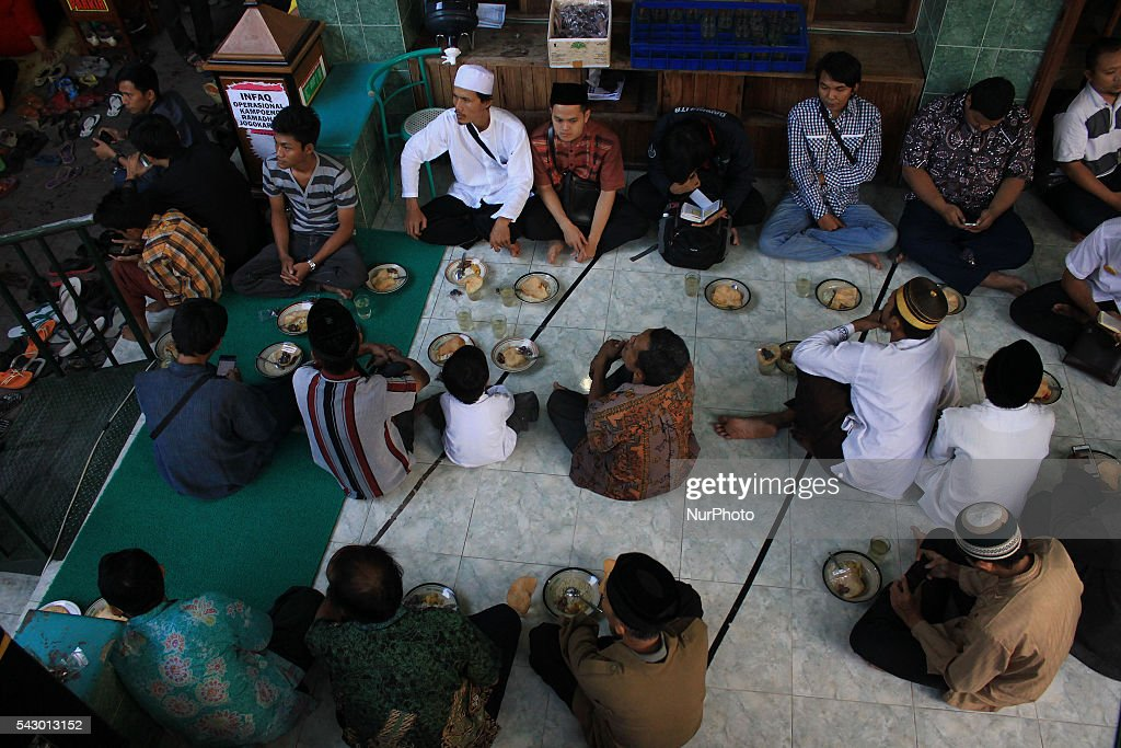 Indonesian Muslims sits as waiting to break fasting at the Jogokariyan Mosque, Yogyakarta, Indonesia on June 25, 2016. The Islamic holy month of Ramadan is celebrated by Muslims around the world marked by fasting, abstaining from food, sex and smoking from dawn to dusk.